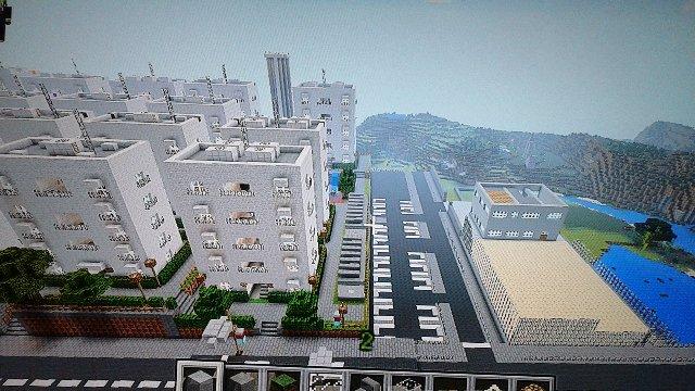 団地全景空撮。右に見えるのは小学校建設予定地です。