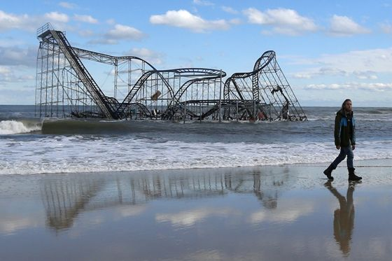 A roller coaster in Seaside Heights, New Jersey becomes submerged after Hurricane Sandy destroys the pier it sat on