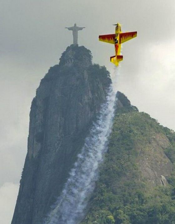 A stunt plane does its best impression of Christ the Redeemer