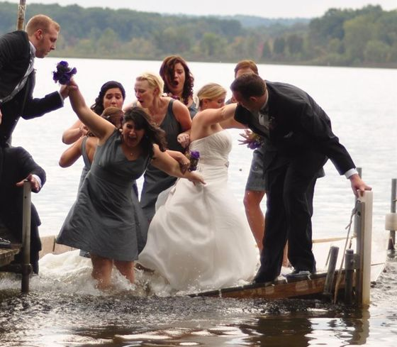The dock under a wedding party gives way the moment their picture was taken