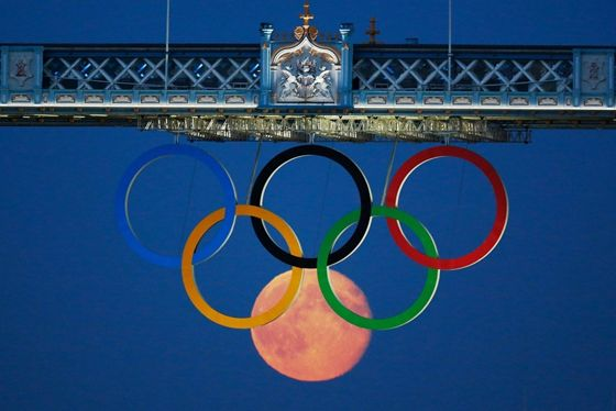 The moon rises over the Olympic games in London
