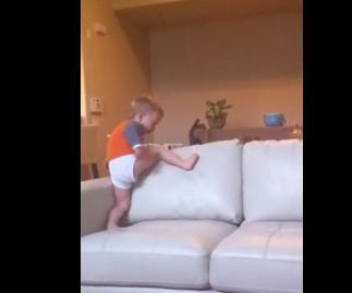 2 years olds kicks the sofa