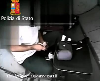 baggage handlers stealing on cam arrested