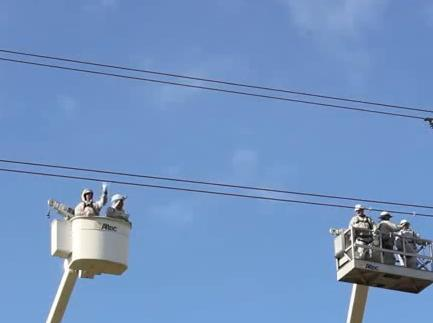 Electrical Workers Play With The Power Lines