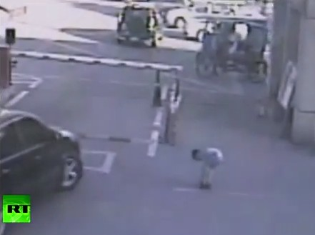 Boy run over by car, crowd lifts vehicle saves him