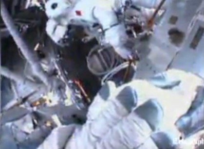 Spacewalk aborted by astronaut after water in helmet