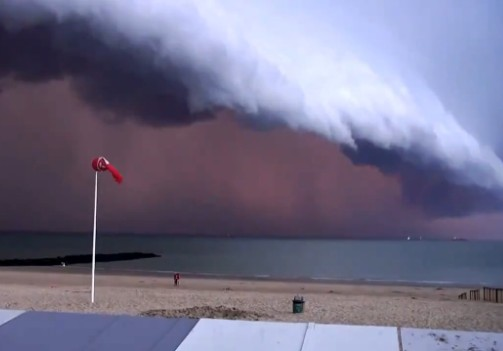 Breathtaking View Of A Storm Front Nearing Beach