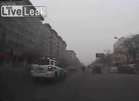 Cop car runs over pedestrian