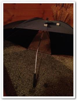 曲がった傘