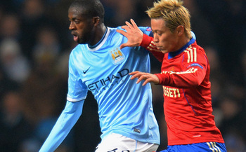 hi-res-187024096-keisuke-honda-of-cska-in-action-with-yaya-toure-of_display_image.jpg